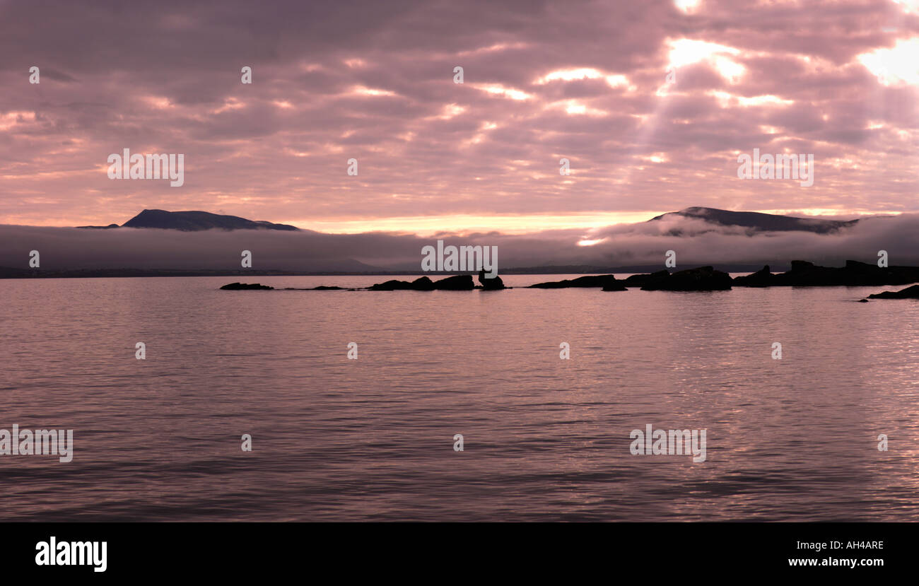 sunbeams over coastline, West coast, Ireland - Stock Image