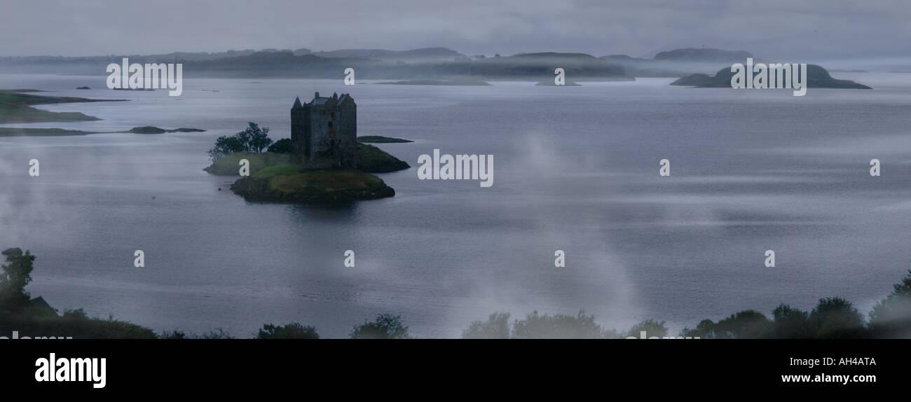 rainfall and fog over Stalker Castle, Scotland Stock Photo