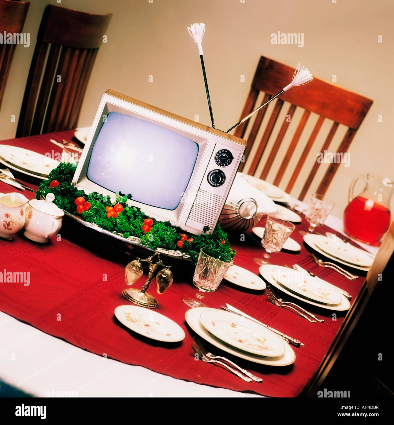 TV on platter on dinner table - Stock Image