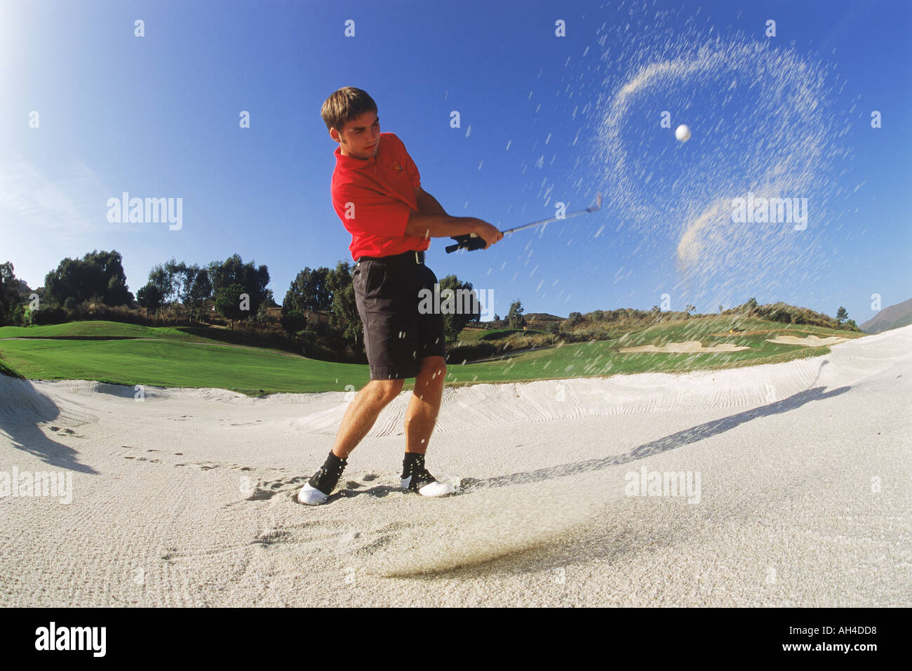 Halo of sand encircliing golf ball hit from bunker on Costa Del Sol course in Spain - Stock Image