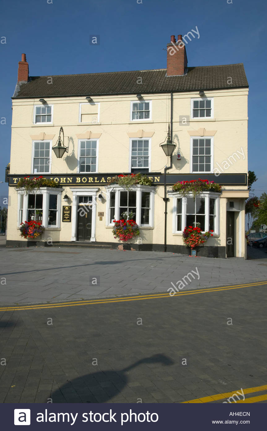 St John Borlase Warren public house freshly painted with coulourful hanging baskets of flowers Canning Circus Nottingham - Stock Image