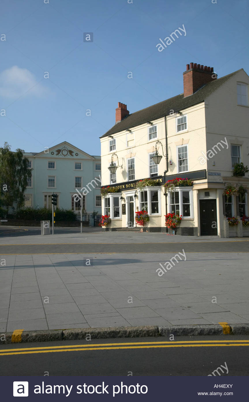 Sir John Borlase Warren public house freshly painted with coulourful hanging baskets of flowers Canning Circus Nottingham - Stock Image