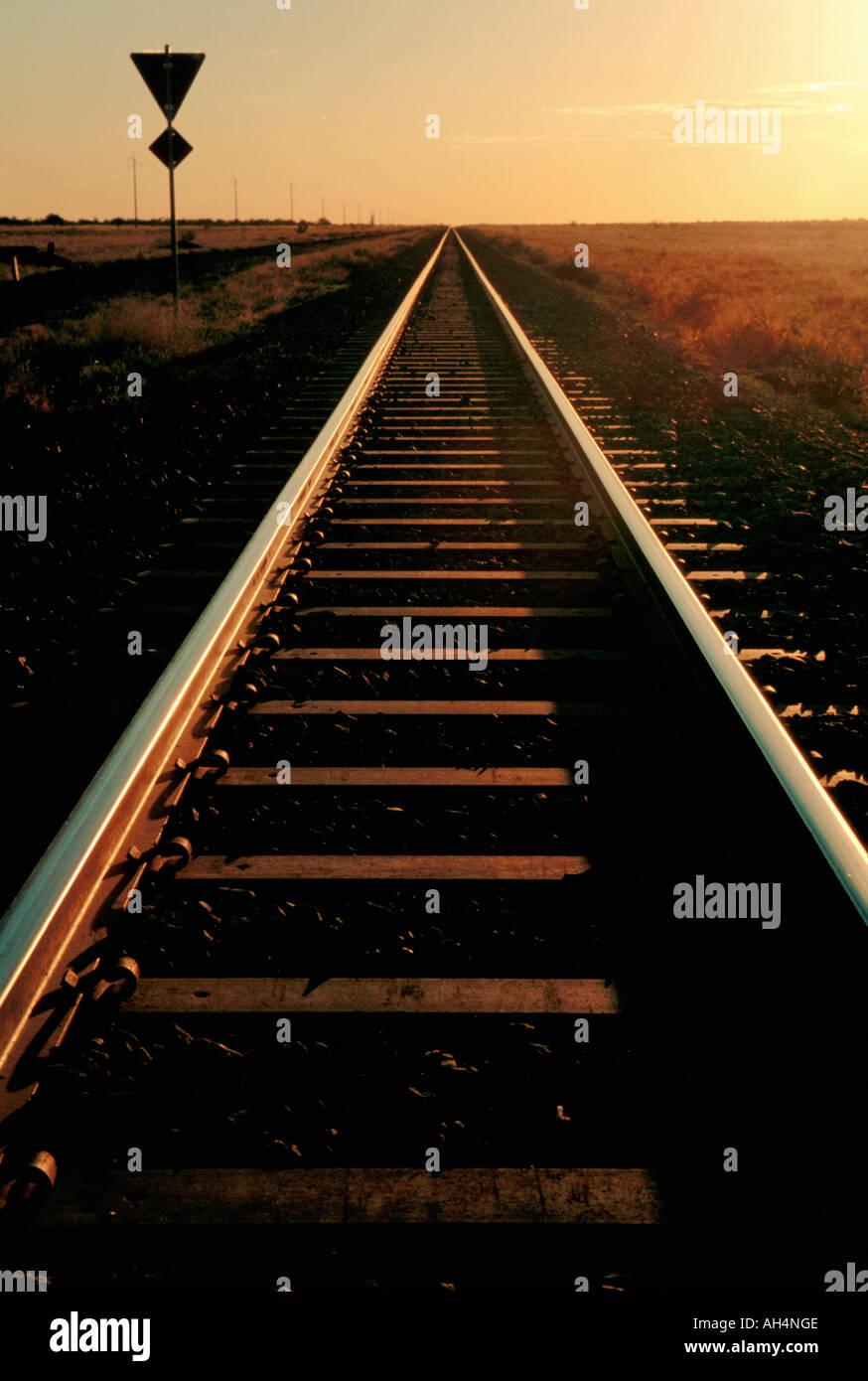 railway tracks crossing landscape, Northern Territory, Australia - Stock Image