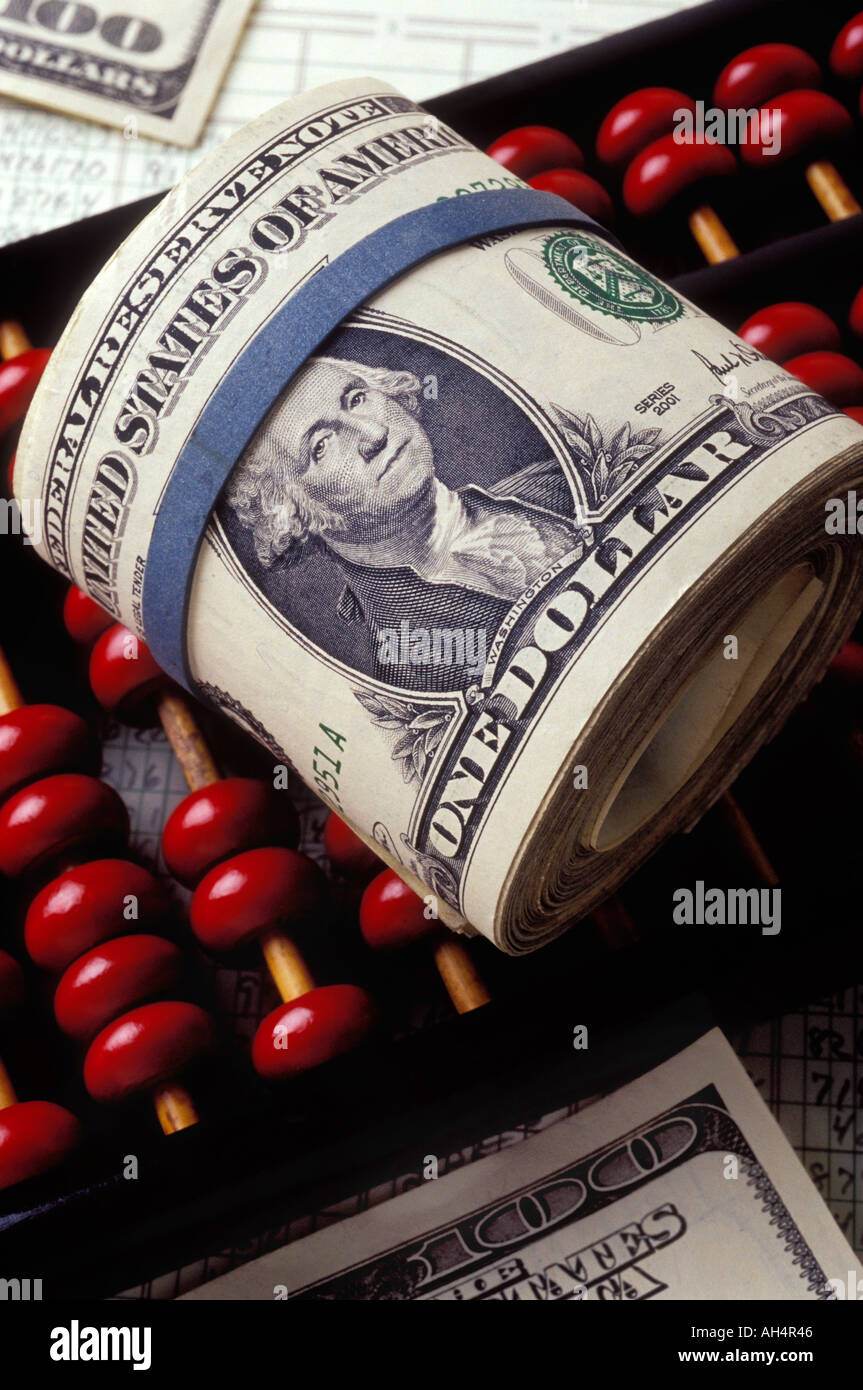 Roll of American money on abacus - Stock Image