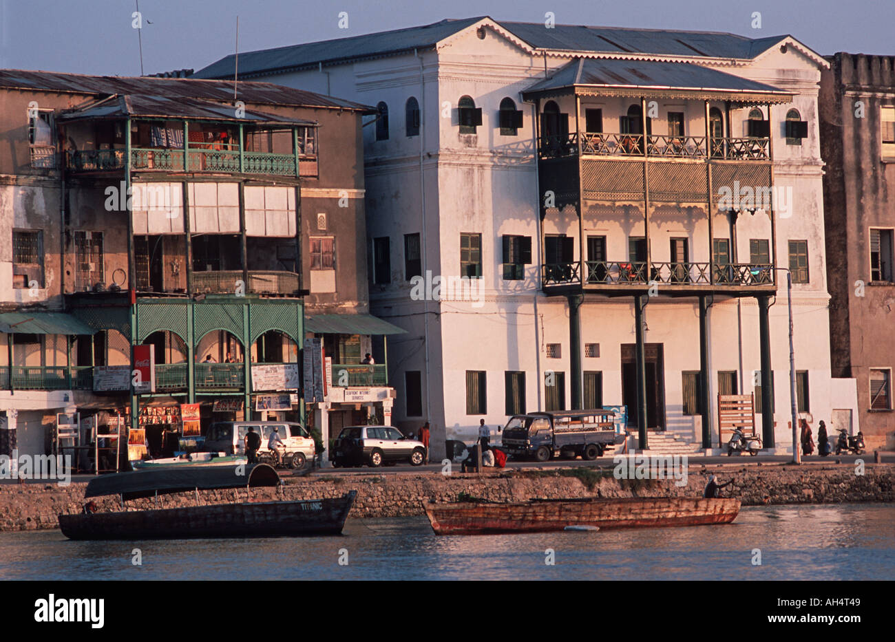 Colonial buildings on Stone Town s historic waterfront at sunset Unguja Zanzibar Tanzania East Africa - Stock Image