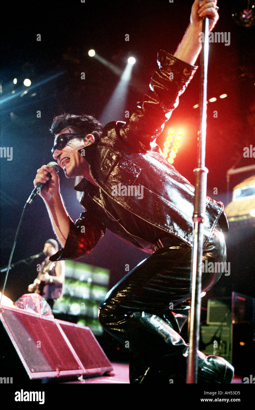 Bono of rock band U2 performing on their Zoo TV tour at the National Exhibition Centre Birmingham UK on 1 June 1992 - Stock Image