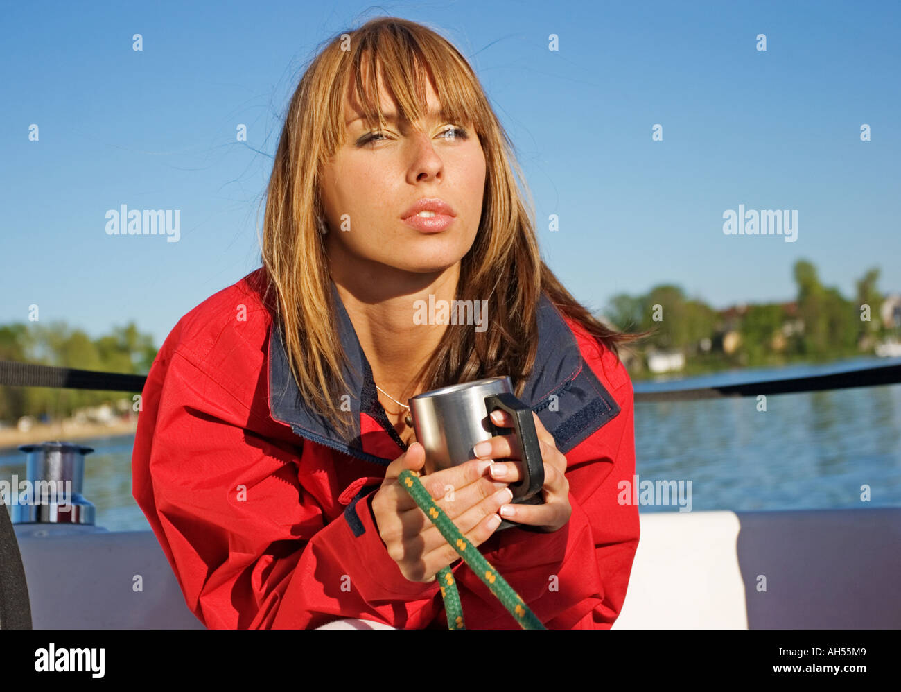 outdoor summer day country lake water woman mature 30 35 blonde long