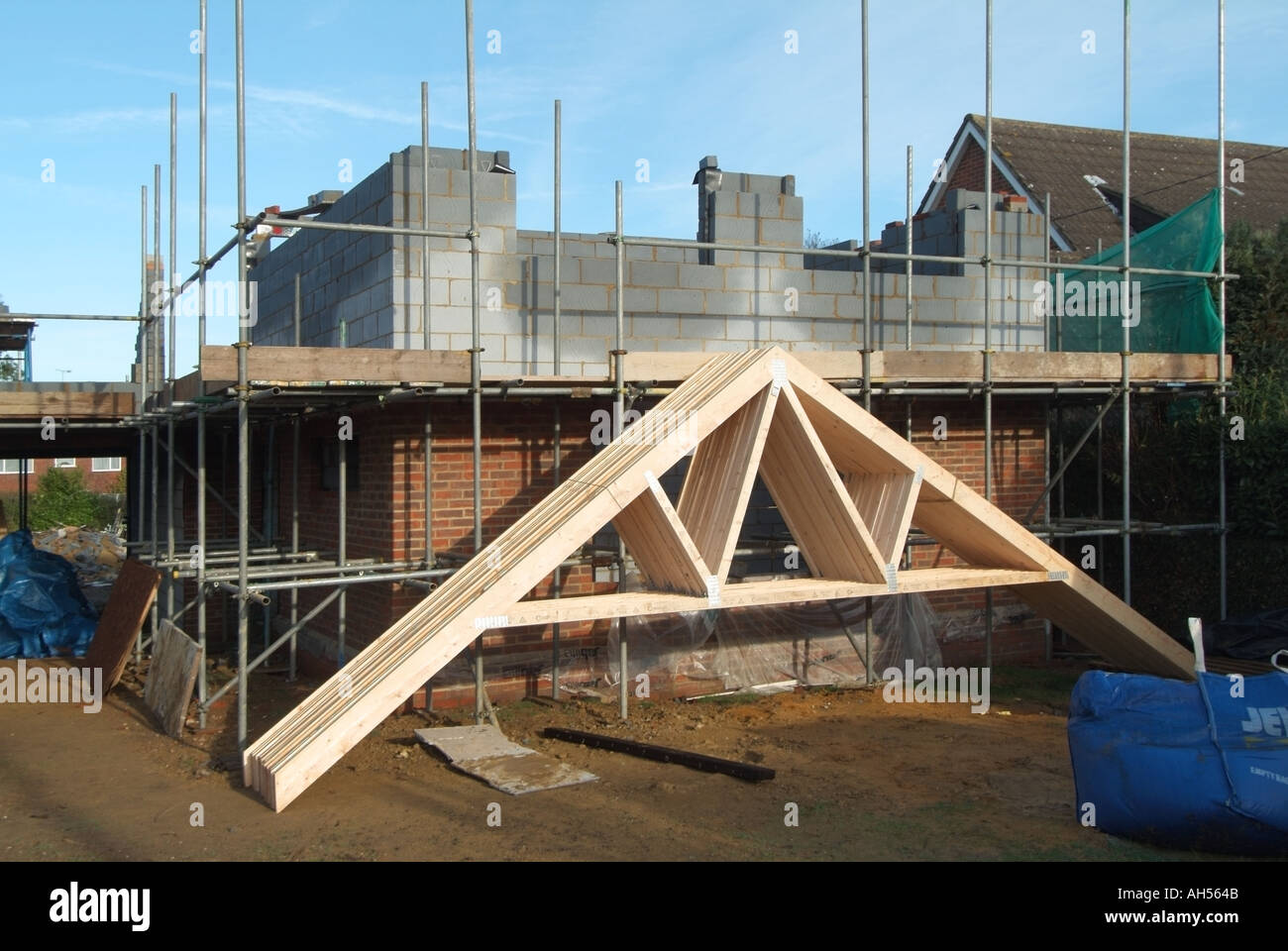 Roof trusses delivered to detached house building site for Manufactured roof trusses