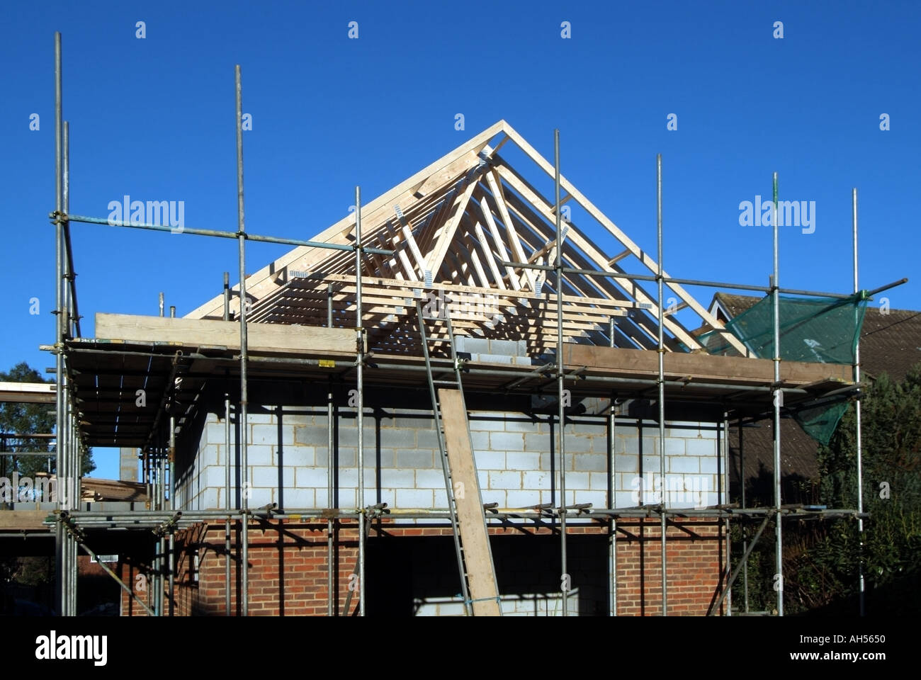 Essex house building site prefabricated roof trusses in for Prefabricated roof