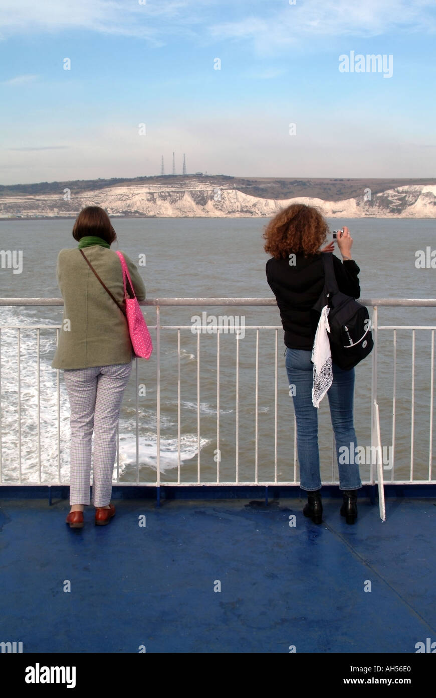 English Channel off Kent coast 2 two passengers on ferry English white chalk cliffs distant Stock Photo
