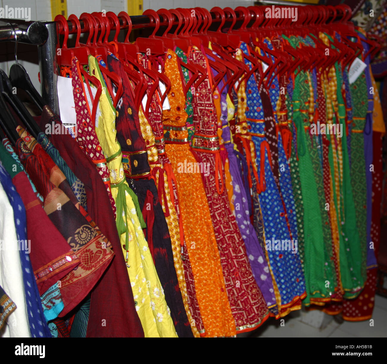 2a3a851888 Colourful Dresses hanging on rail in Indian dress shop Stock Photo ...