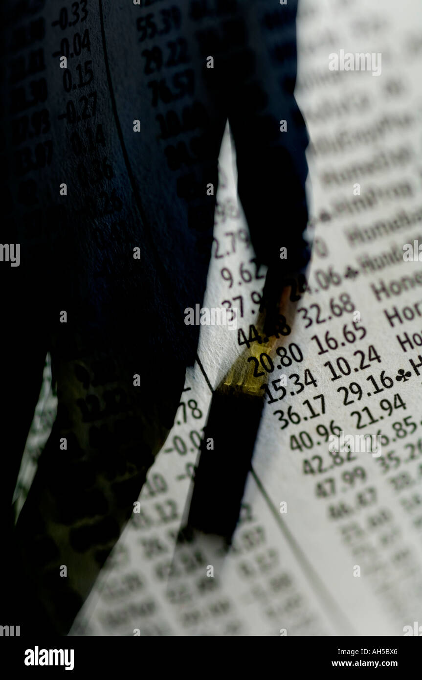 business man with briefcase walking over background of stock market prices - Stock Image