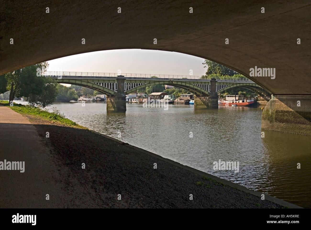Richmond railway bridge on the River Thames London viewed from Twickenham bridge - Stock Image
