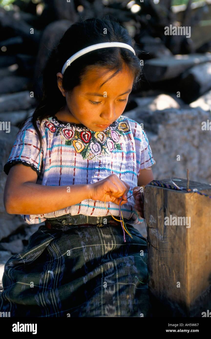 Girl making friendship bracelet Santiago Atitlan Guatemala Central America - Stock Image