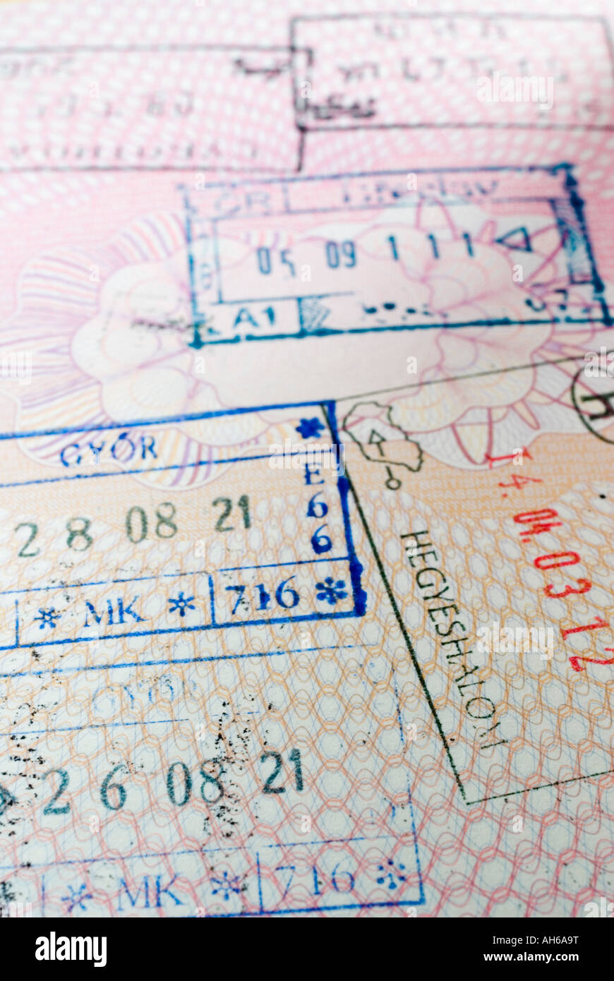 Page of UK passport with East European entry visas - Stock Image