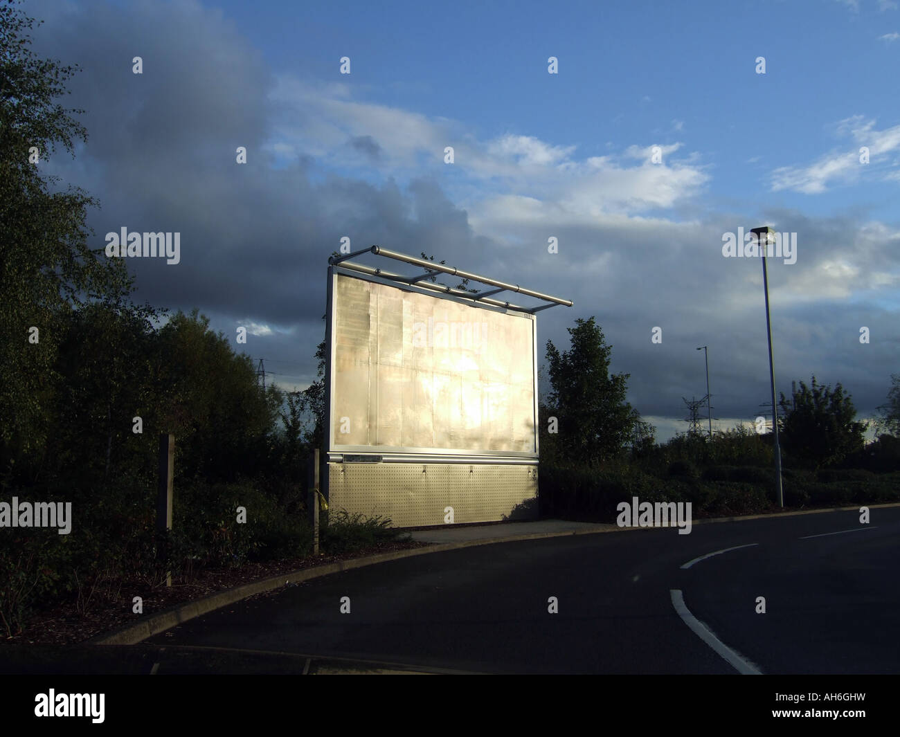 An advertising hoarding reflecting the sunlight - Stock Image