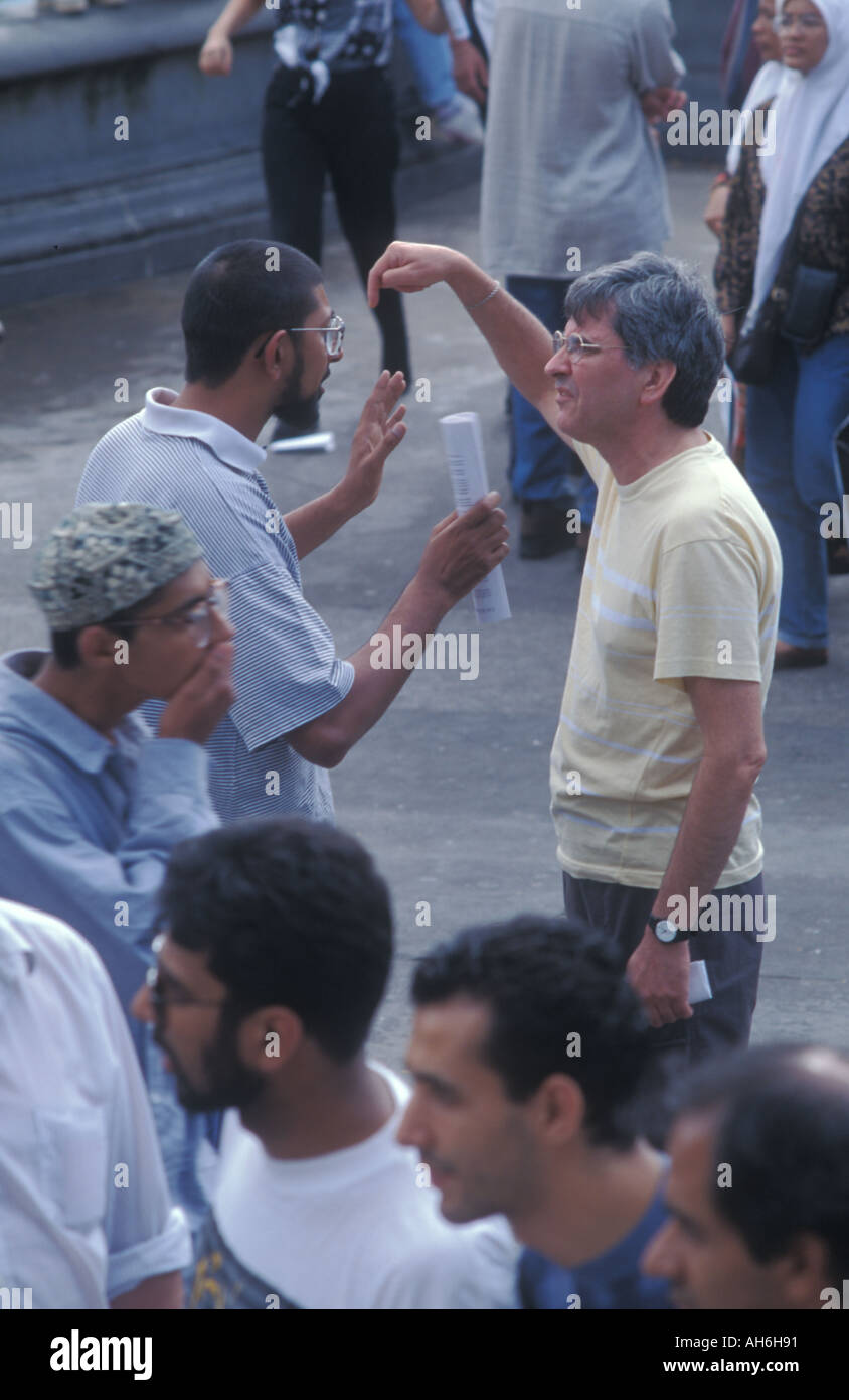 A Muslim argues the pros of Islam to a non believer at a Rally for Islam in Trafalgar Square, London ,August 93 - Stock Image