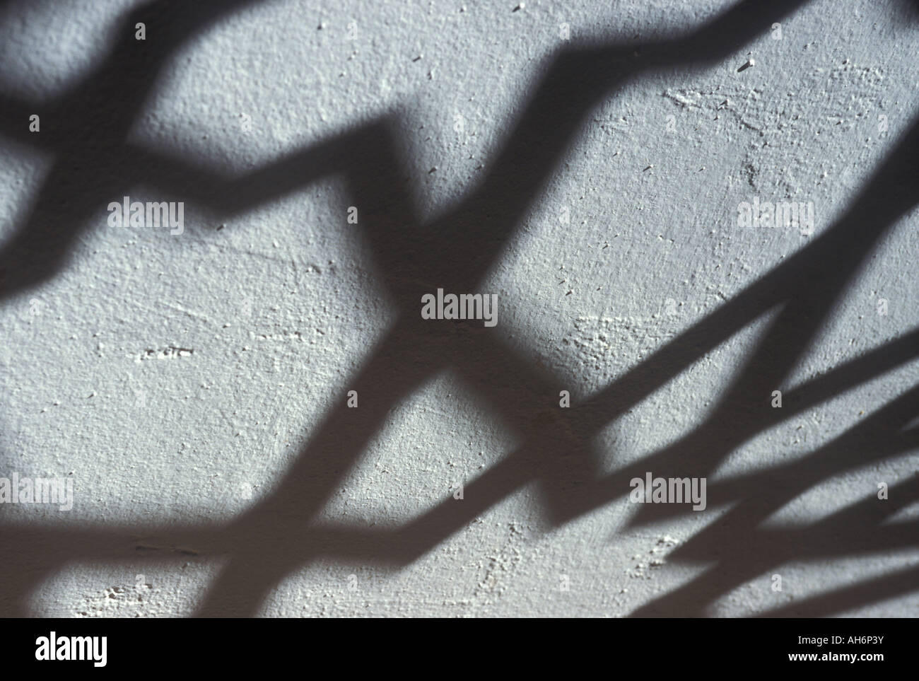 Arabesque shadows on a whitewashed wall, Andalusia - Stock Image