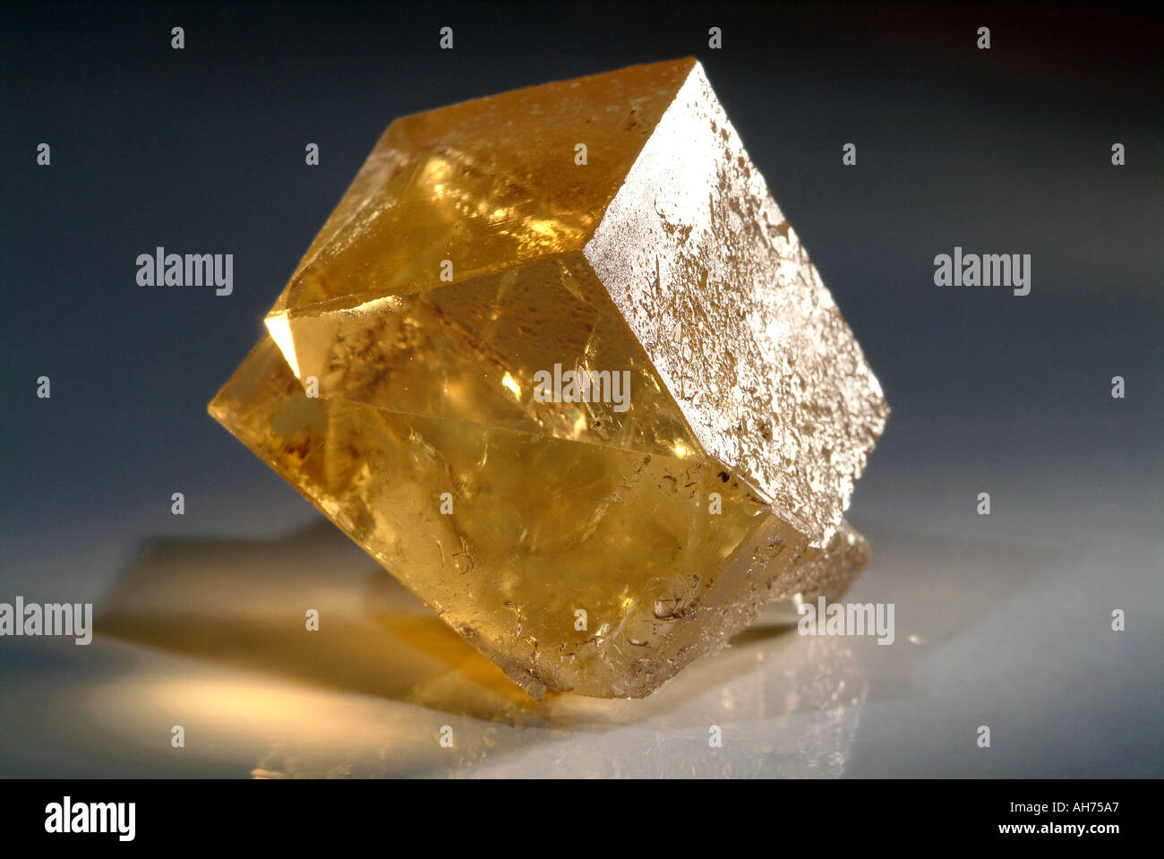 Mineral Fluorite, Single twin on transparent yellow fluorite, Hilton mine, Scordale, Cumbria, England - Stock Image