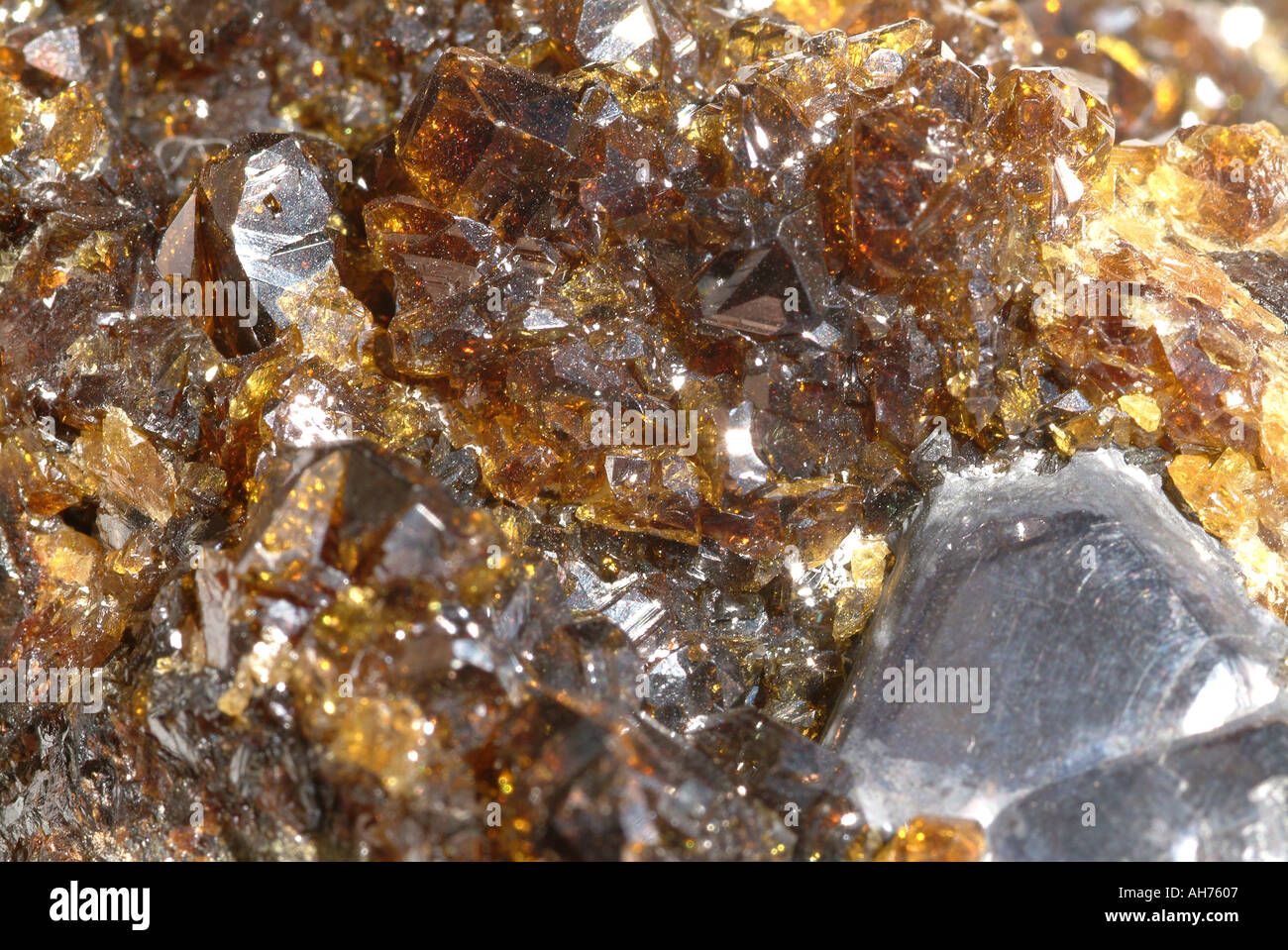 Mineral Sphalerite, Ruby sphalerite translucent honey coloured crystals with single galena crystal, Mogul Silver mines, Tipperary, Ireland - Stock Image
