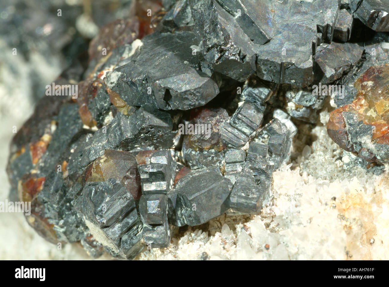 Mineral Bournonite, Bournonite crystals with ruby sphalerite crystals on quartz, Wheal Boys, St. Endellion, Cornwall, England - Stock Image