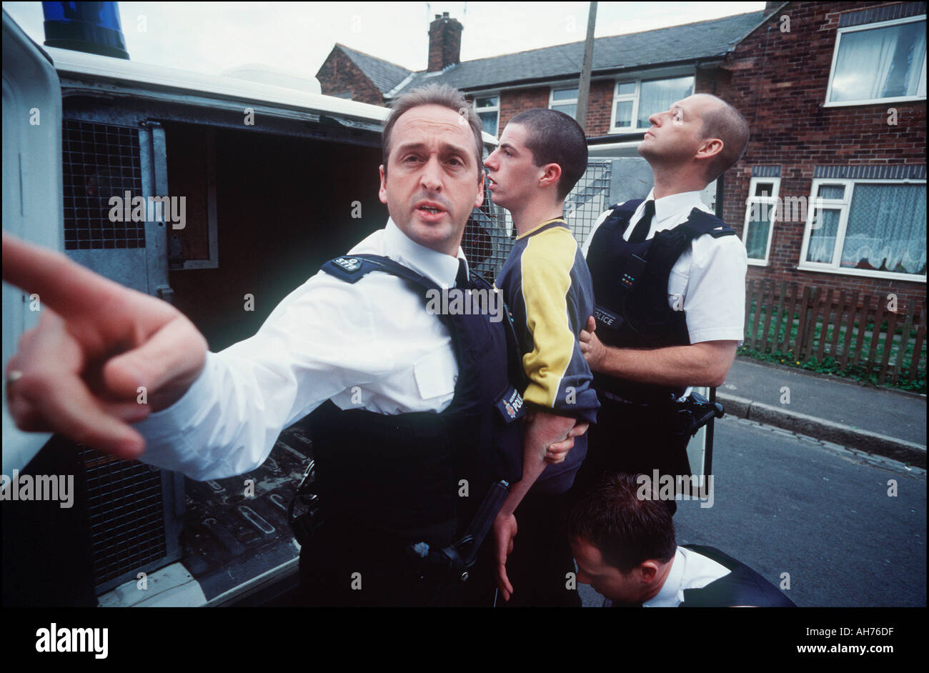 Police officers arrest youths during the riots in Oldham - Stock Image