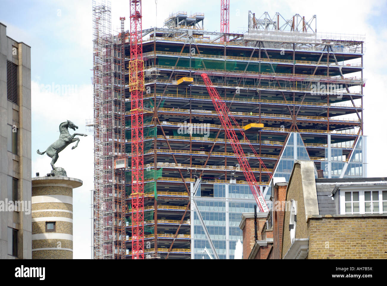 City of London high rise office block under construction glass cladding panels being fitted to steel frame Bishopsgate Stock Photo