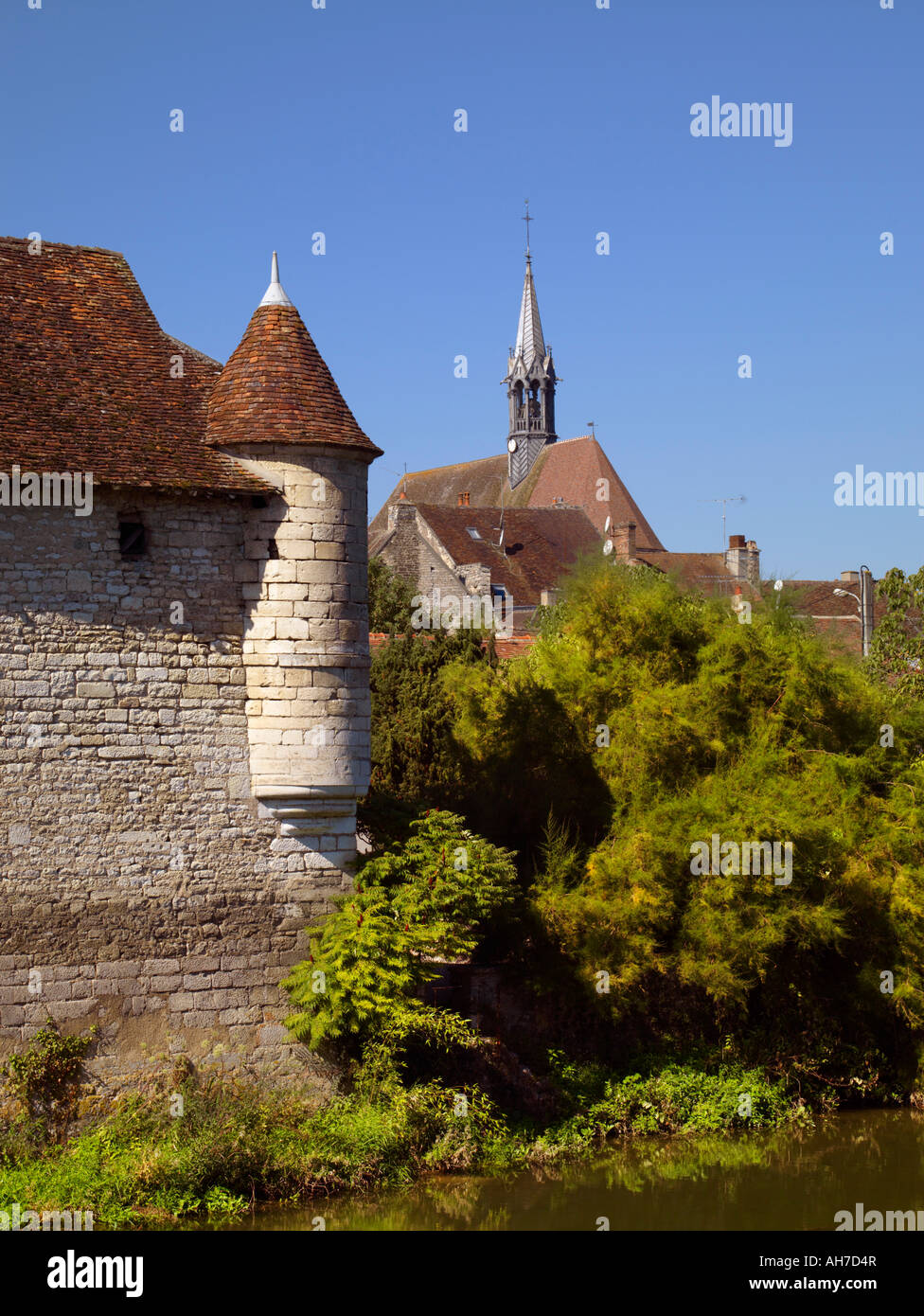 St Martin Collegiate Church viewed over the Serein River in Chablis Yonne France - Stock Image