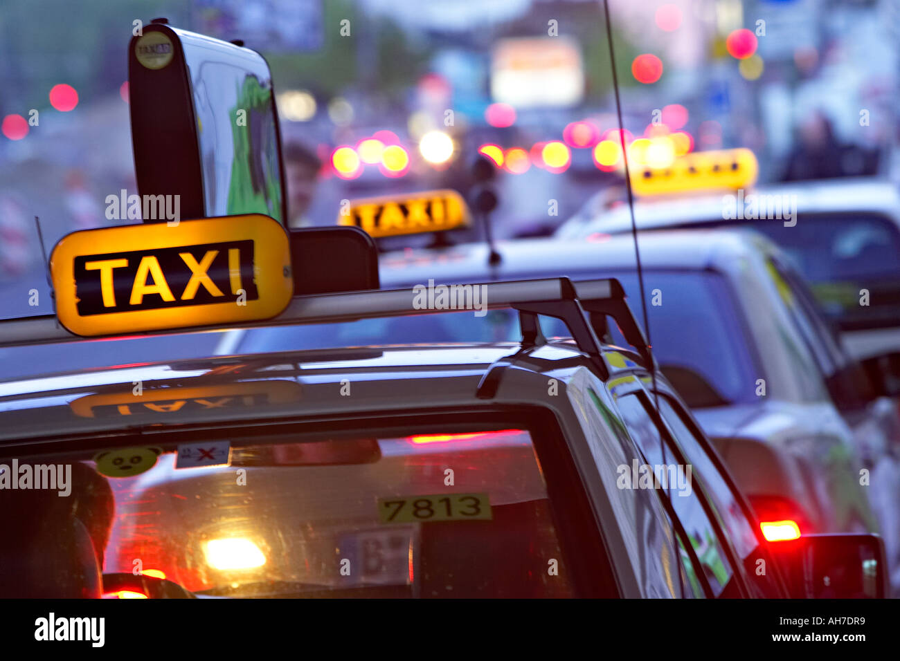 Taxi s in line waiting for passengers in Berlin Germany auto automobile autos car cars land transportation motor car transport - Stock Image