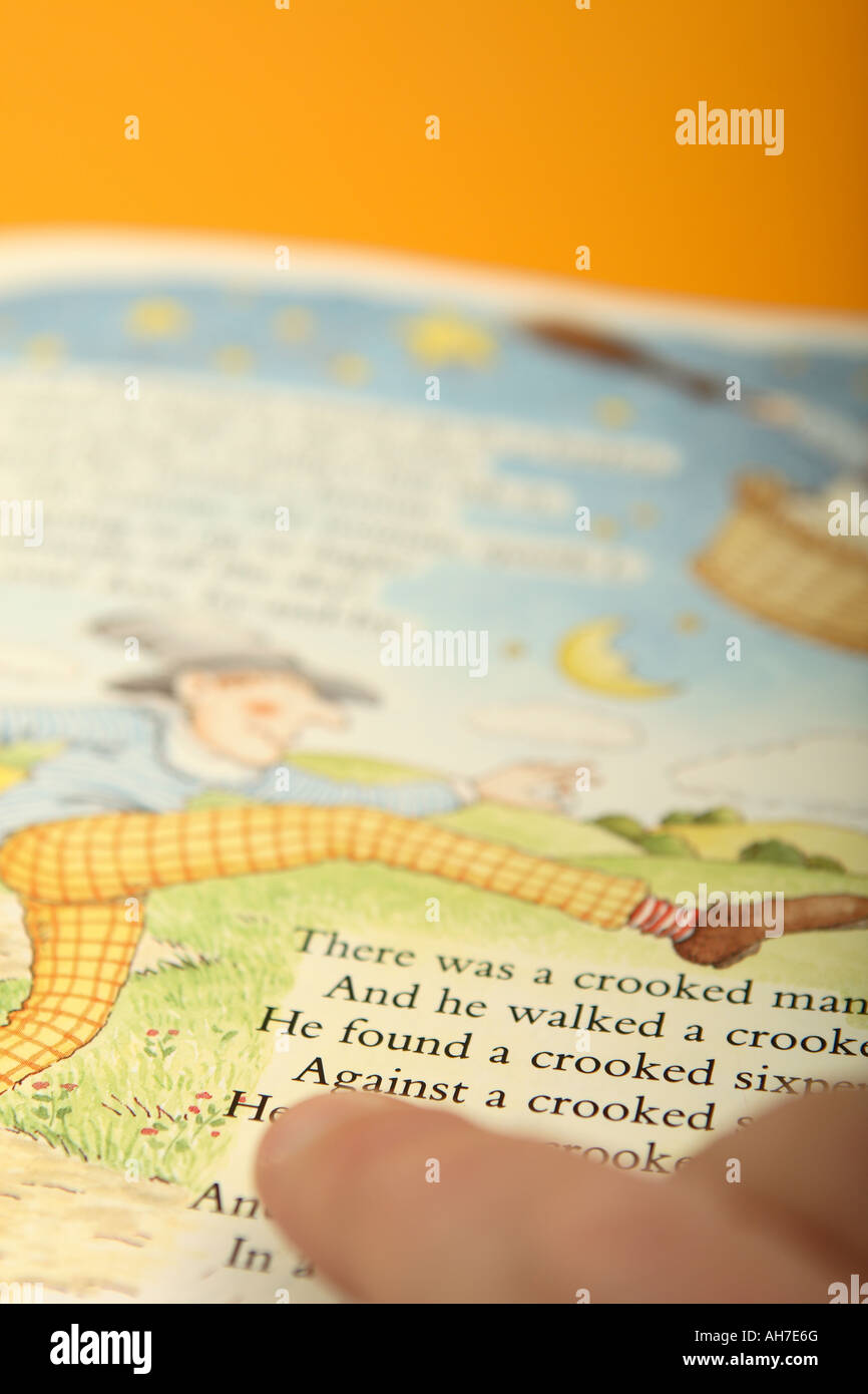 Reading children nursery rhyme story - Stock Image