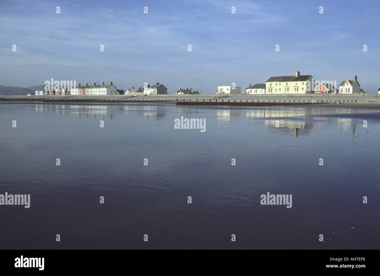 Reflections in wet sand at Borth, Ceredigion - Stock Image