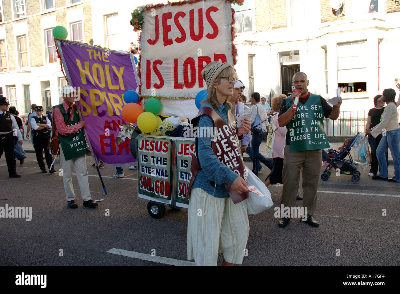 Group of religious cult advocates preaching and spreading their word through street of London. - Stock Image