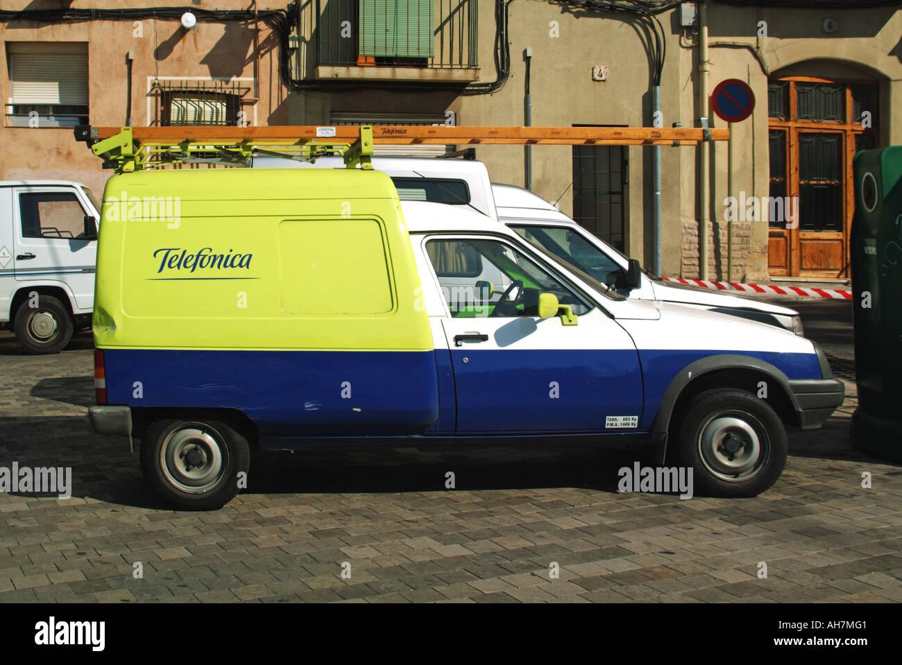Tarragona dented Telefonica engineers van parked - Stock Image