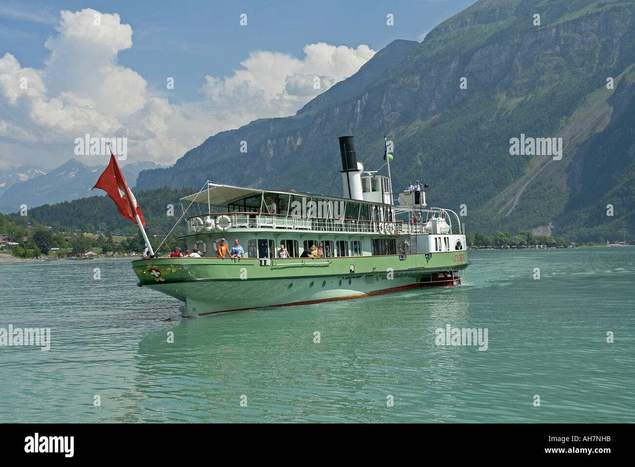 The preserved paddle steamer Lotschberg reversing into berth at Brienz Switzerland on a sunny summer day - Stock Image