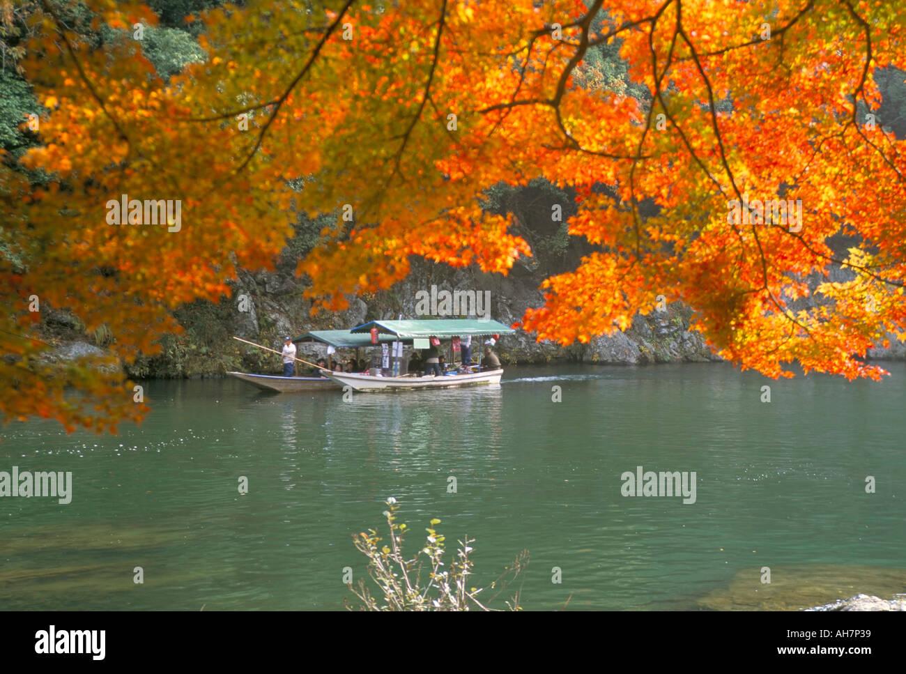 Autumn maples traditional boats on the Hozu River Arashiyama Kyoto Japan Asia - Stock Image