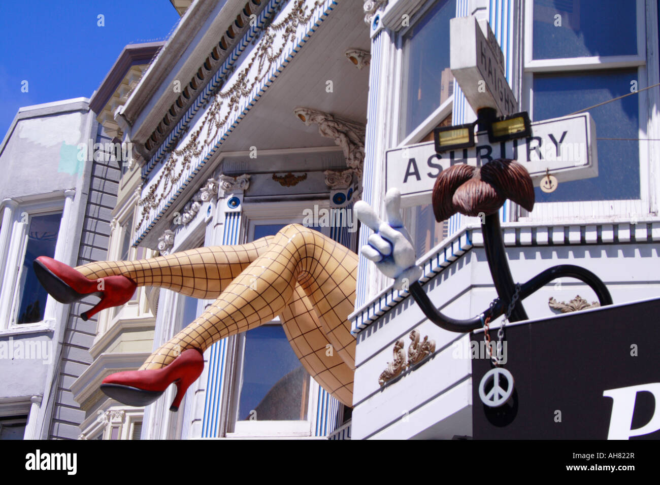 Giant legs hanging out of apartment window, Haight Ashbury, San Francisco Stock Photo