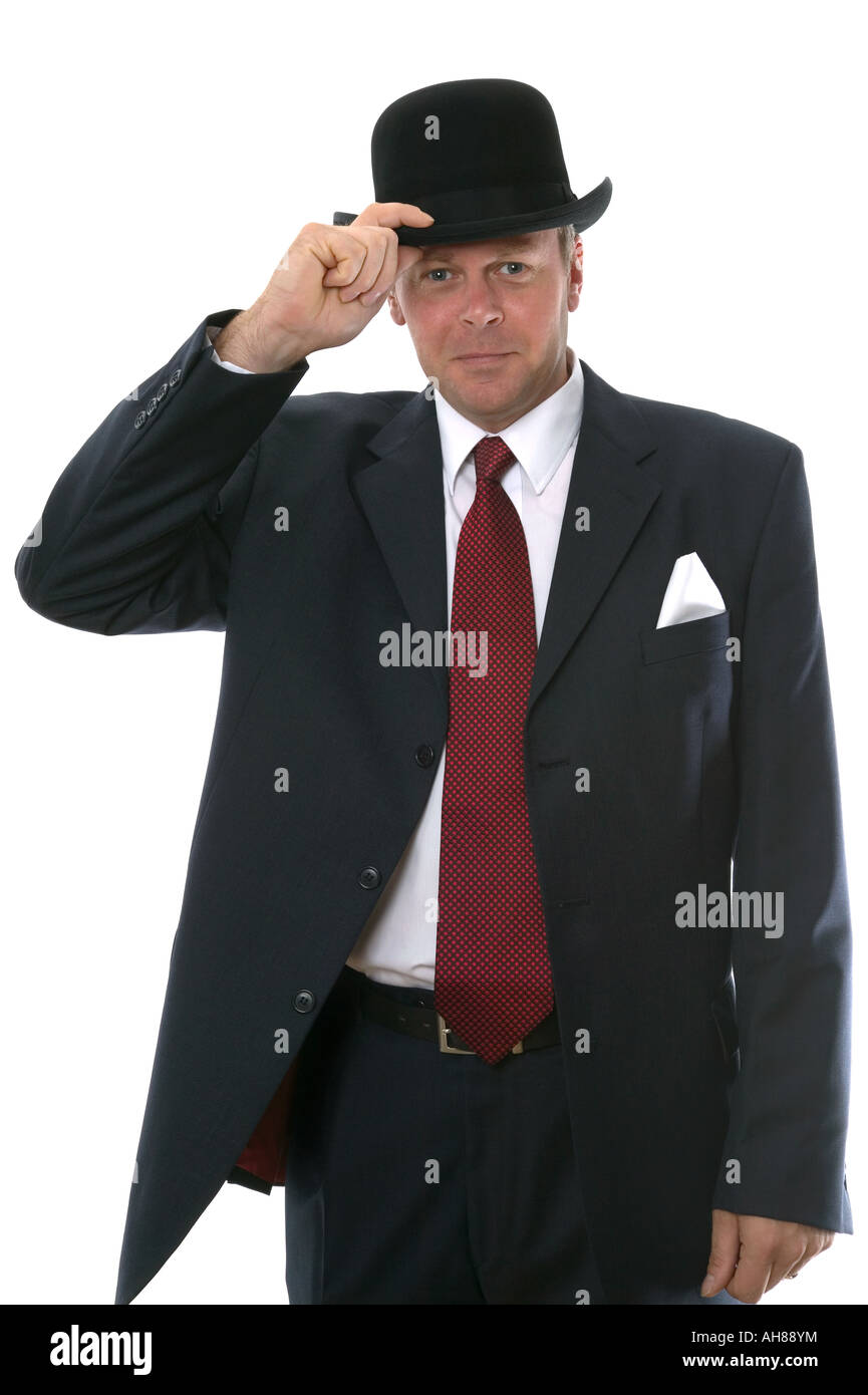 Businessman in bowler hat gesturing a welcome - Stock Image