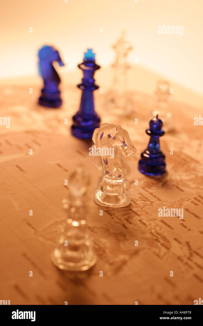 Chess Pieces on World Map - Stock Image