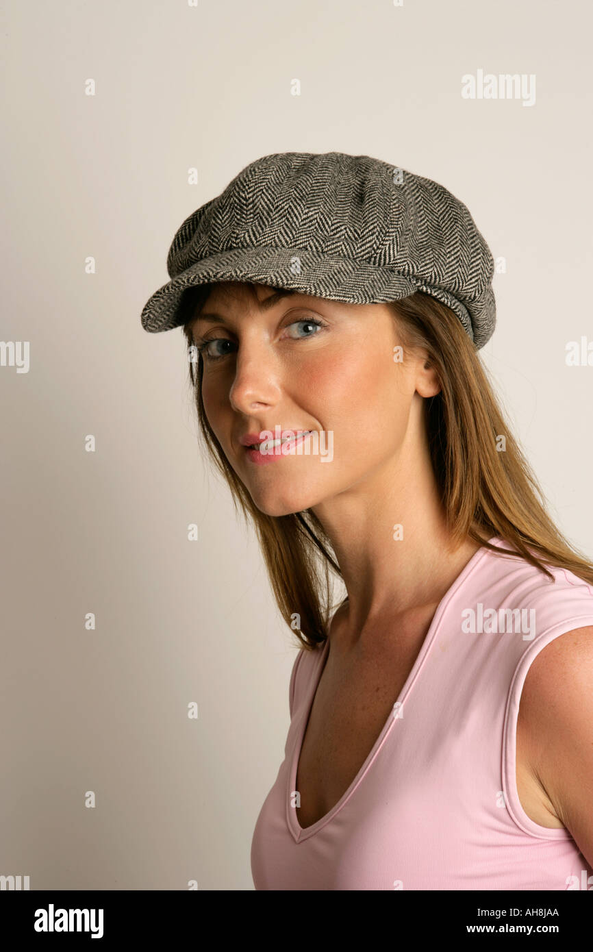 b811b2f072829 Young woman wearing a peaked hat Stock Photo  4698793 - Alamy
