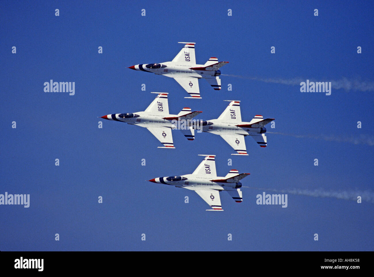 United States Airforce Thunderbirds flying their Lockheed Martin F 16 Fighting Falcon - Stock Image