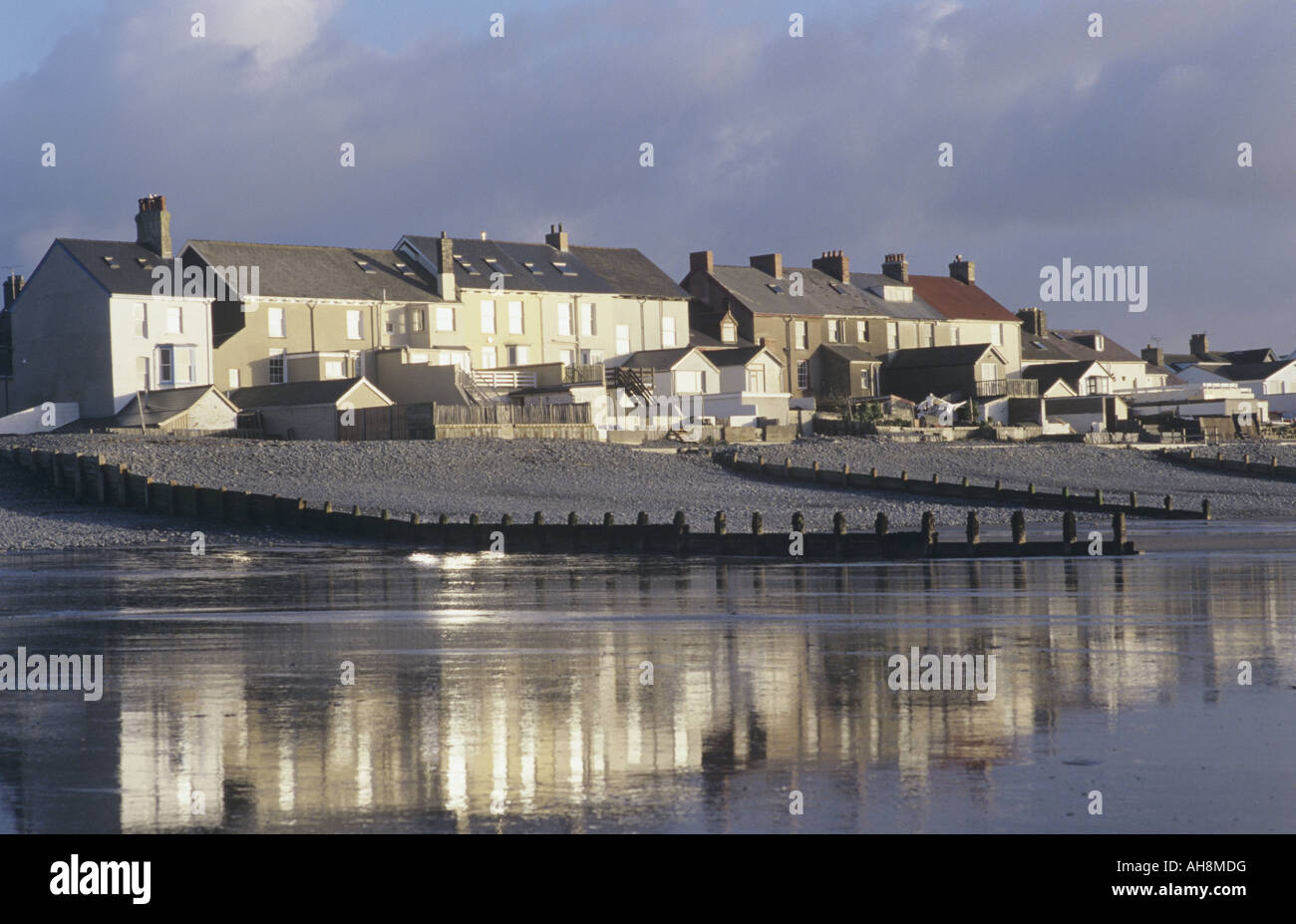 Reflections of houses in wet sand at Borth, Ceredigion - Stock Image