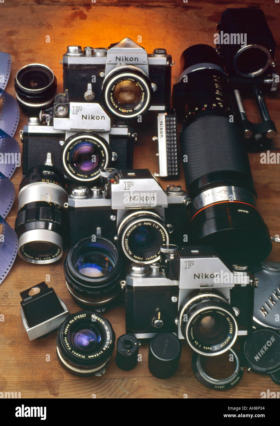 Nikon F Cameras SLR Bodies wide angle lenses tele photo lens film prism finder cap Evolution of Photography - Stock Image