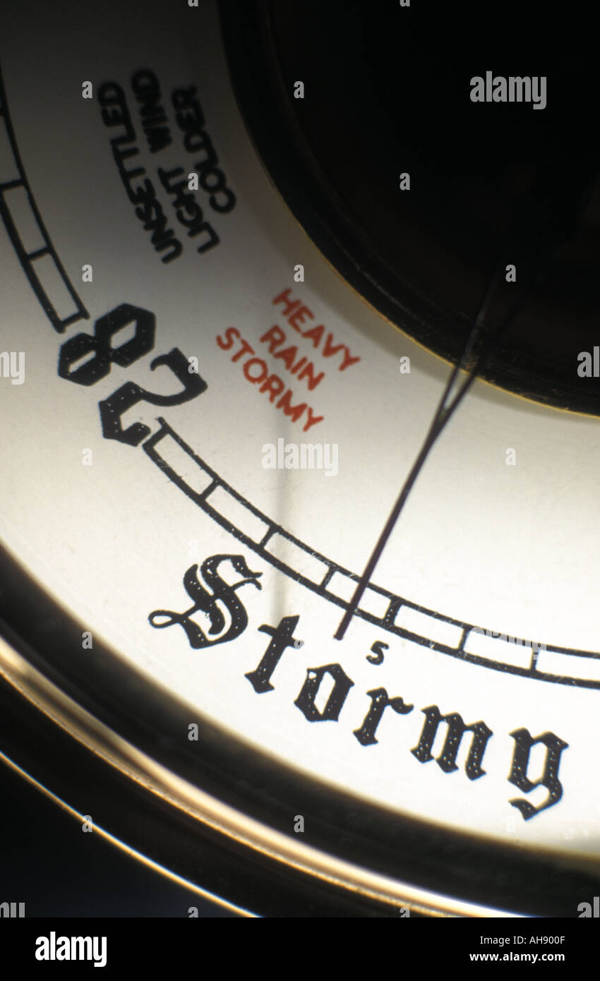 Old barometer showing stormy weather - Stock Image