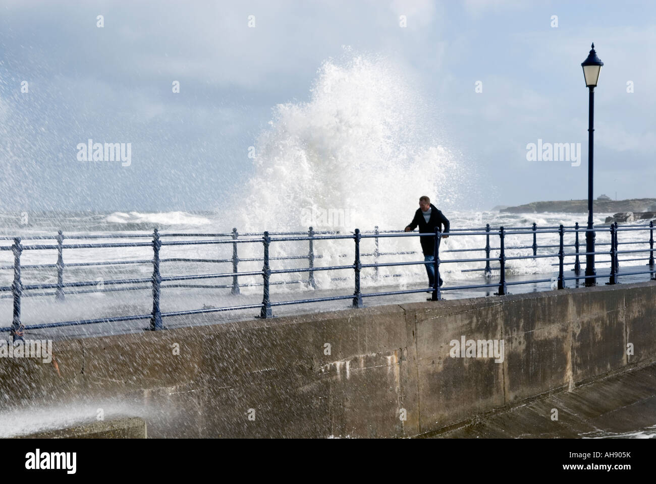 Wave dodging at  Amble in Northumberland 'Great Britain' - Stock Image