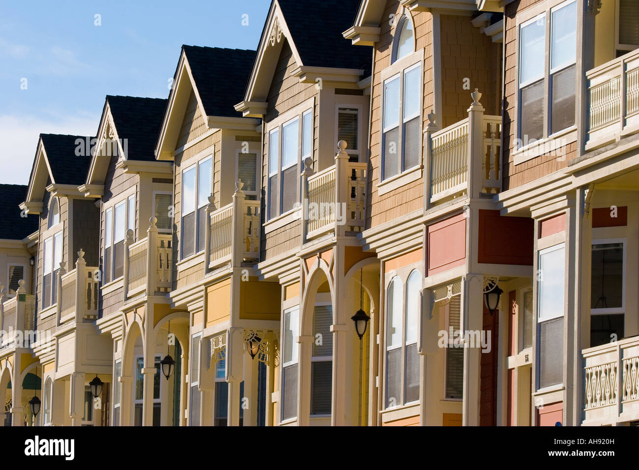 Row houses in the Victorian architecture style with bay windows balconies and arched entrances in Santa Cruz California - Stock Image