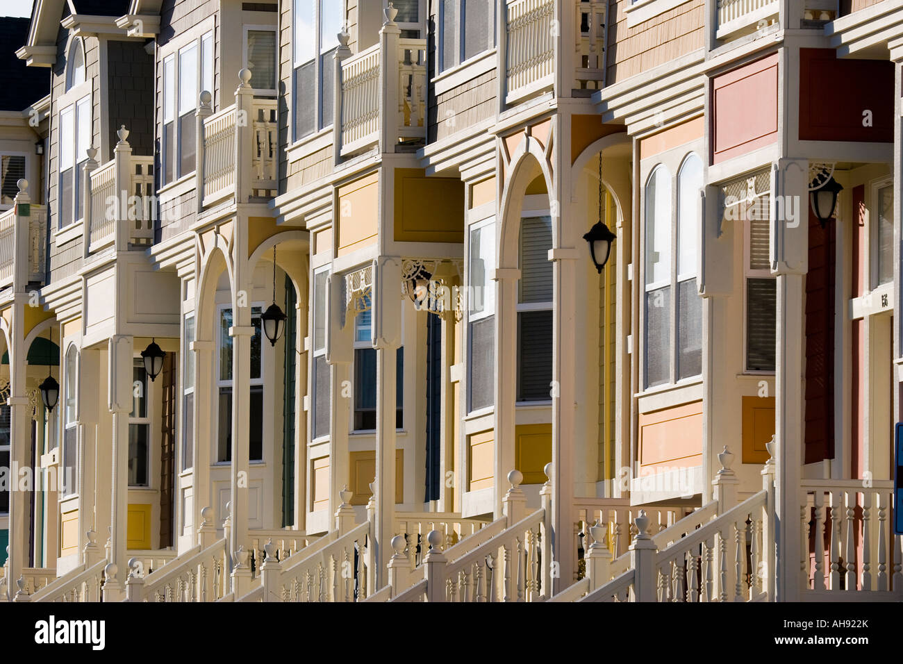 Row houses in the Victorian architecture style with bay windows railings and arch entrances in Santa Cruz California - Stock Image