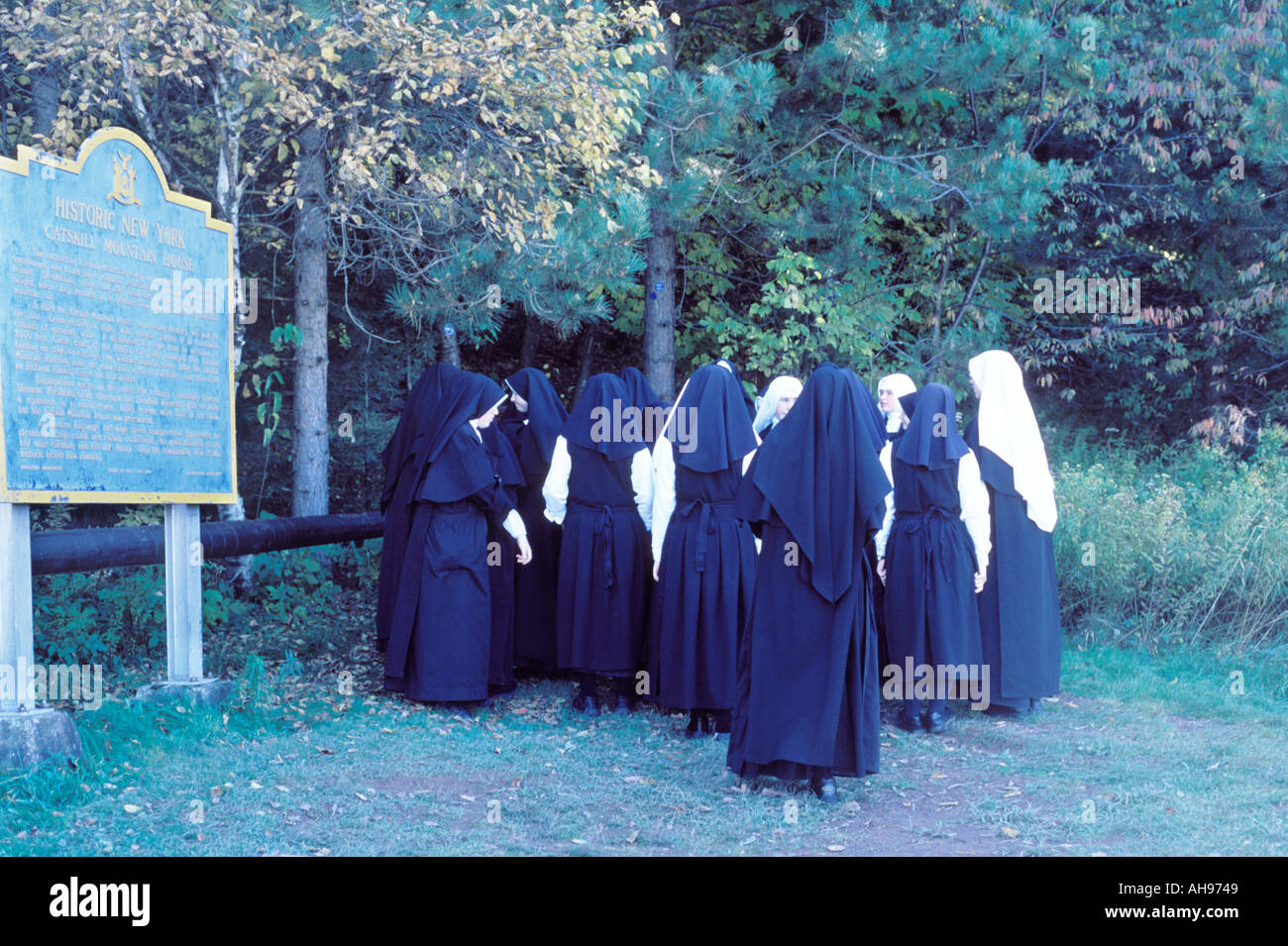 A group of nuns prepare for a hike in the Catskill Mountains Boulder Rock Trail South and North Lake Catskill State Park US - Stock Image