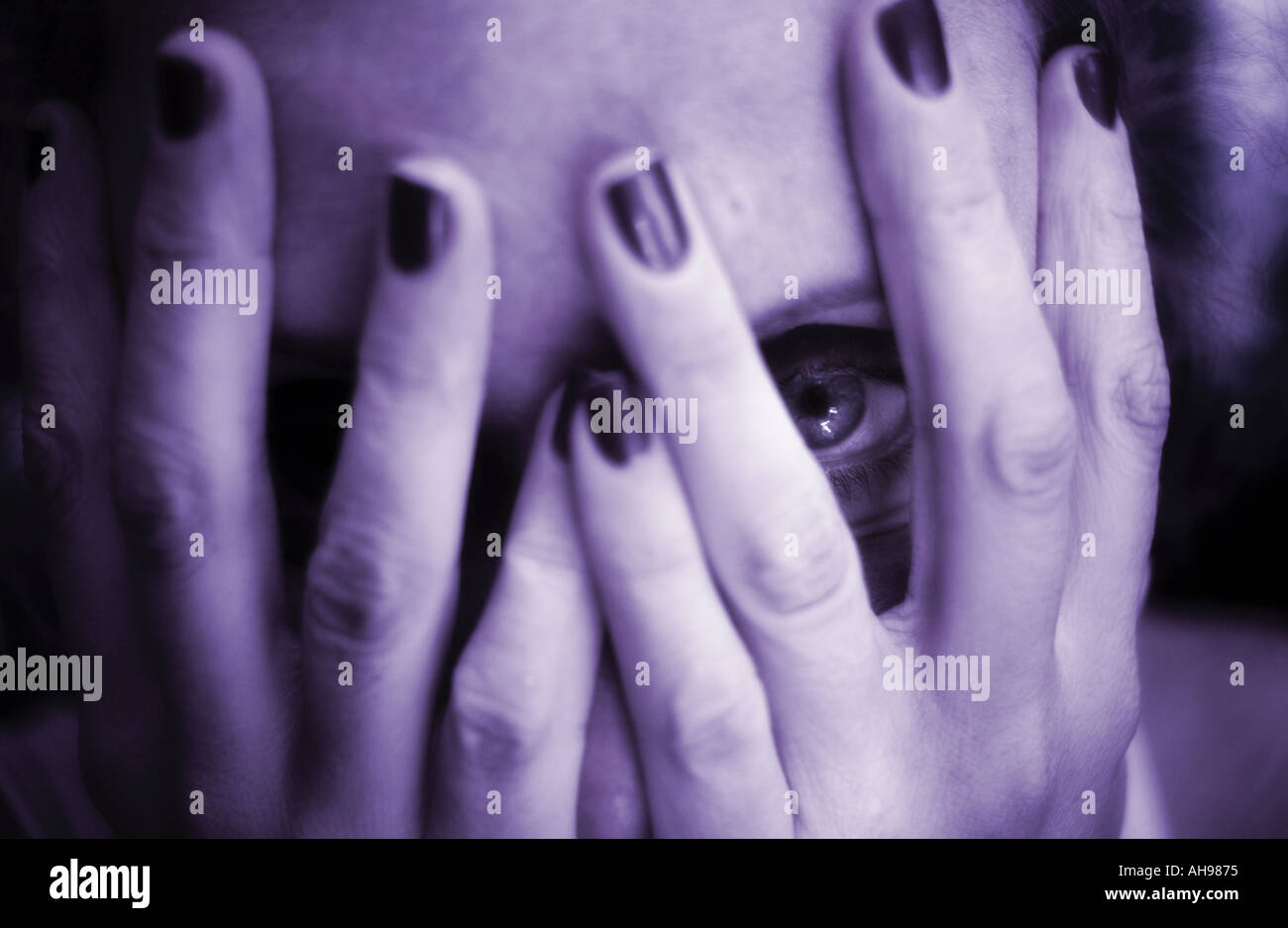 hide hiding Woman covering face looking with eye - Stock Image