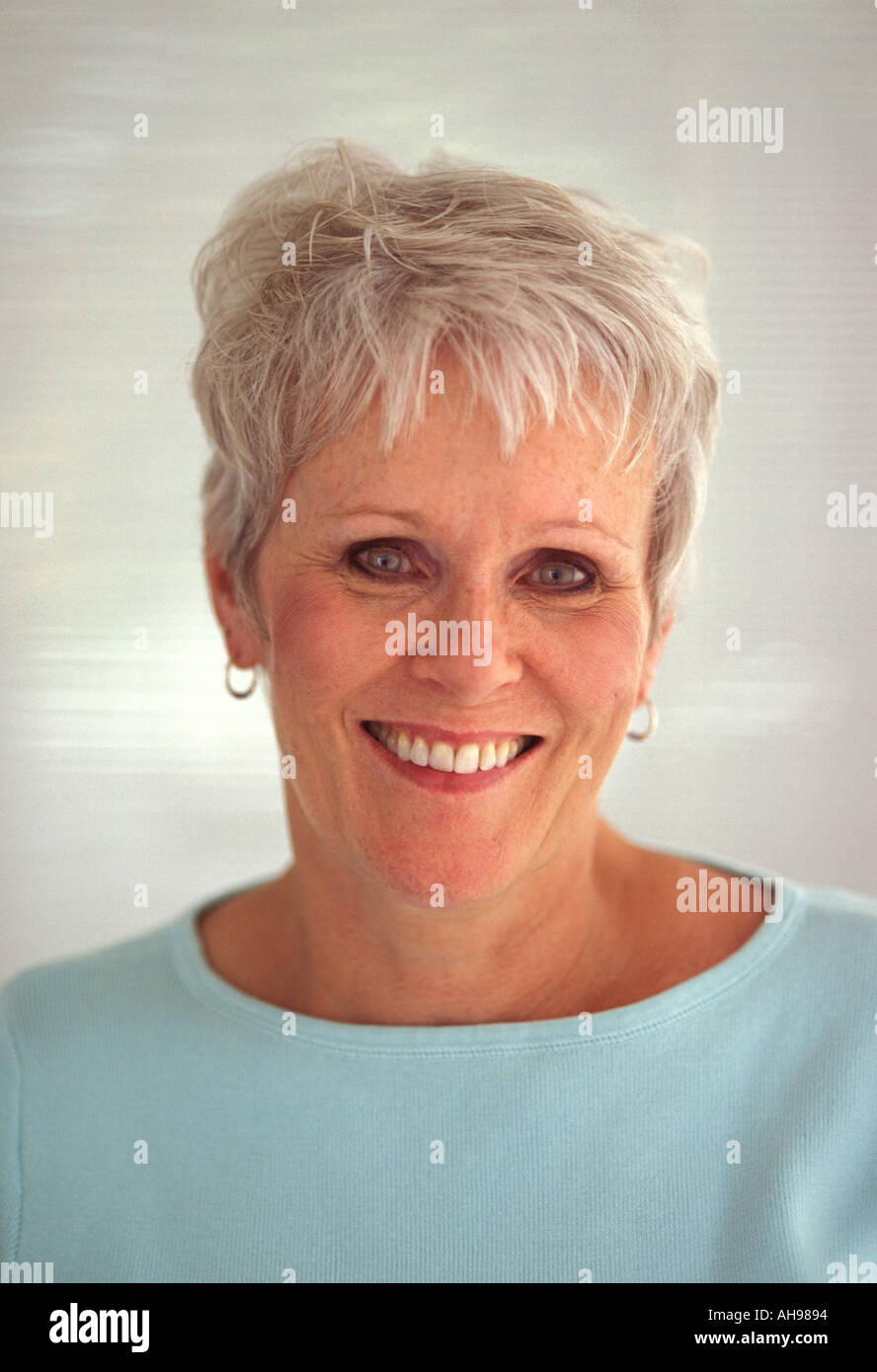 Woman 40 50 smiling face - Stock Image