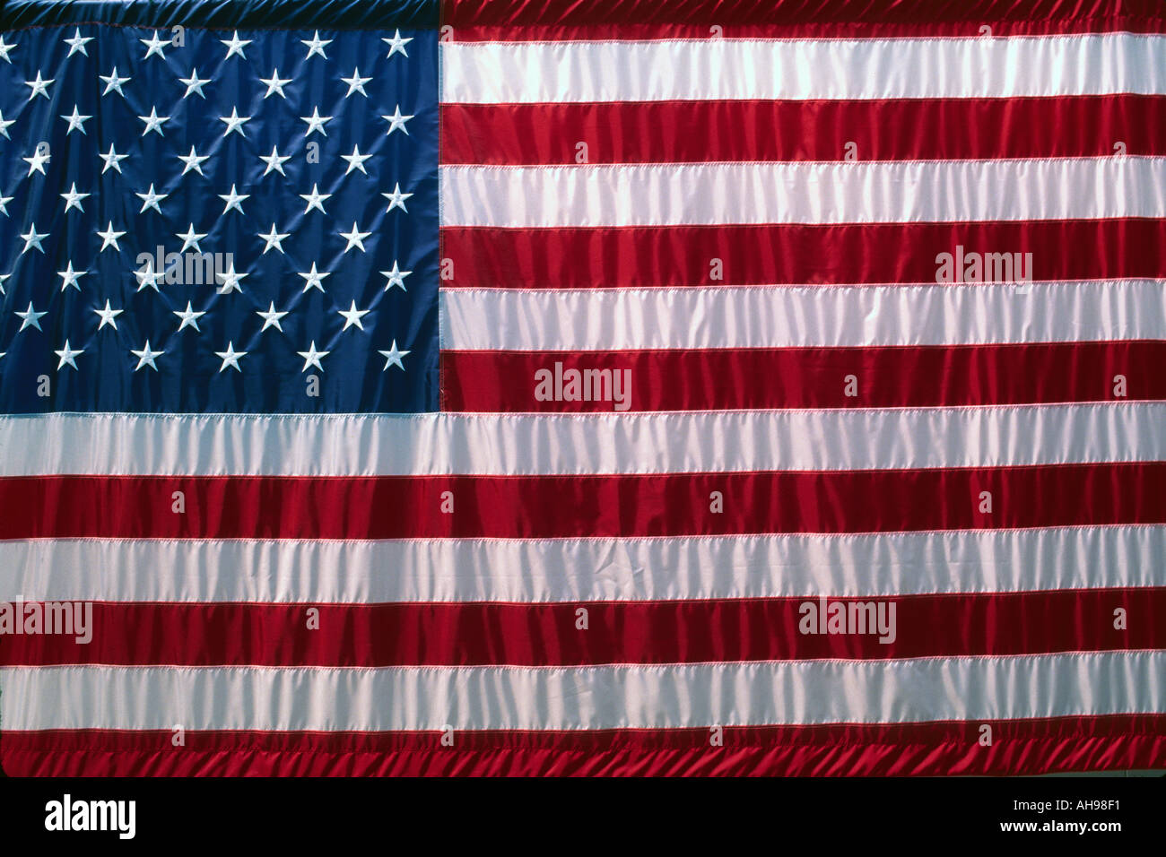 American flag hanging on a wall - Stock Image